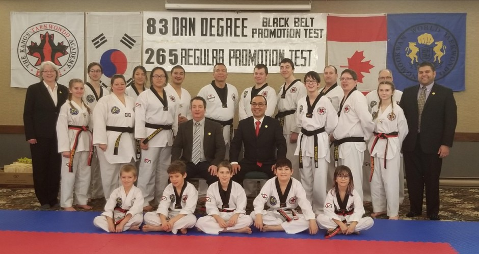 Photo of Poom and Black Belt Members at Promotion Test